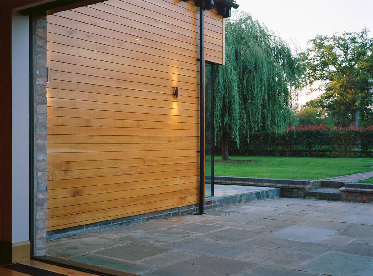 Structural Frameless Glass : Structural glazing with frameless glass doors clear living