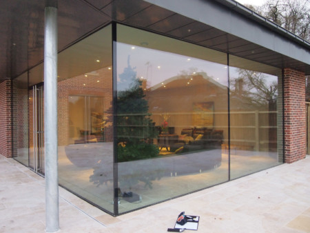 Oversized glass panels with ClearGlaze frameless glass doors.