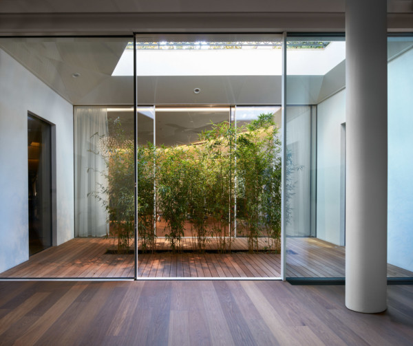 Sky-frame sliding doors and large fixed glass walk on roof lights.